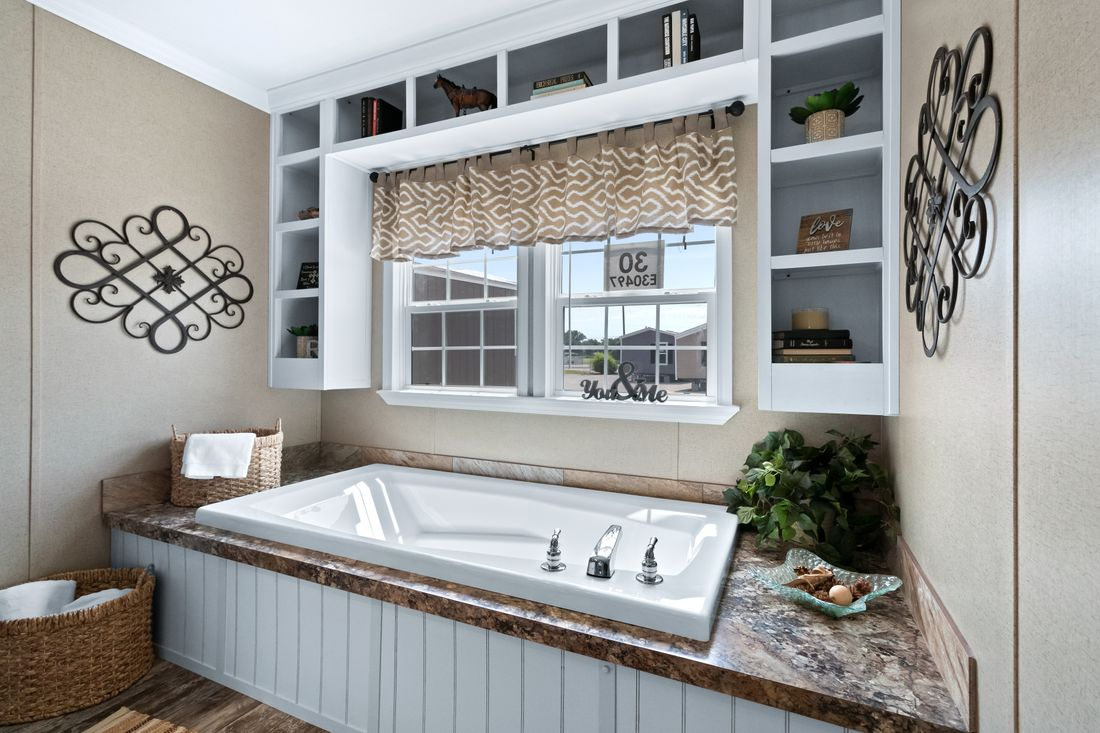 The THE DRAKE Master Bathroom. This Manufactured Mobile Home features 4 bedrooms and 2 baths.
