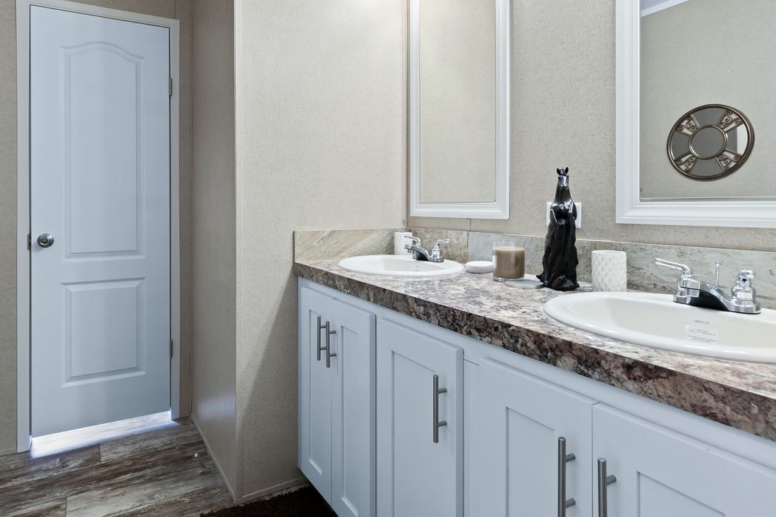 The THE DRAKE Guest Bathroom. This Manufactured Mobile Home features 4 bedrooms and 2 baths.