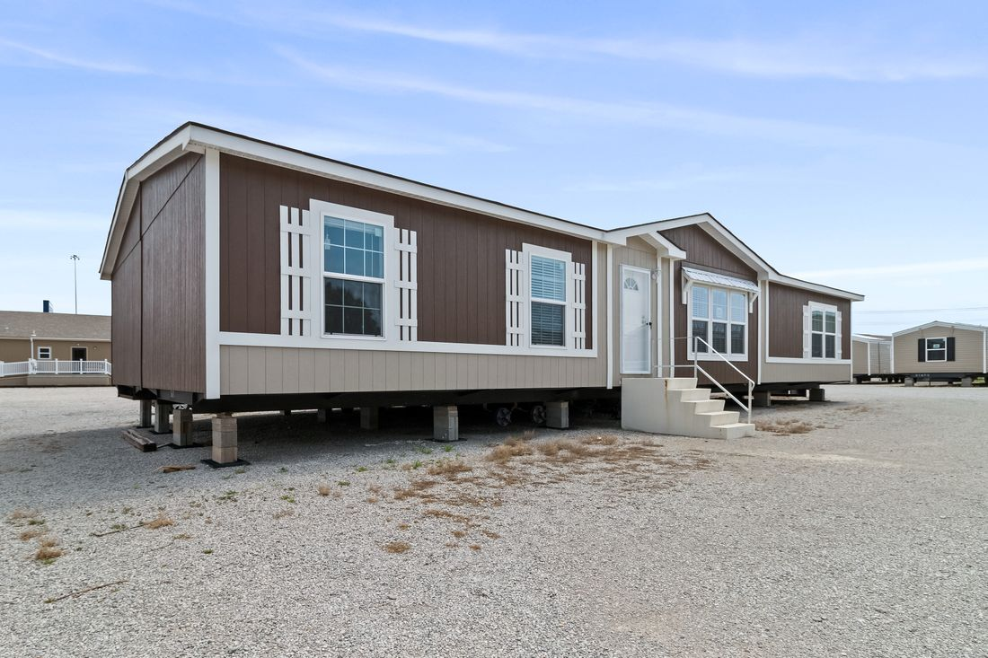 The THE DRAKE Exterior. This Manufactured Mobile Home features 4 bedrooms and 2 baths.