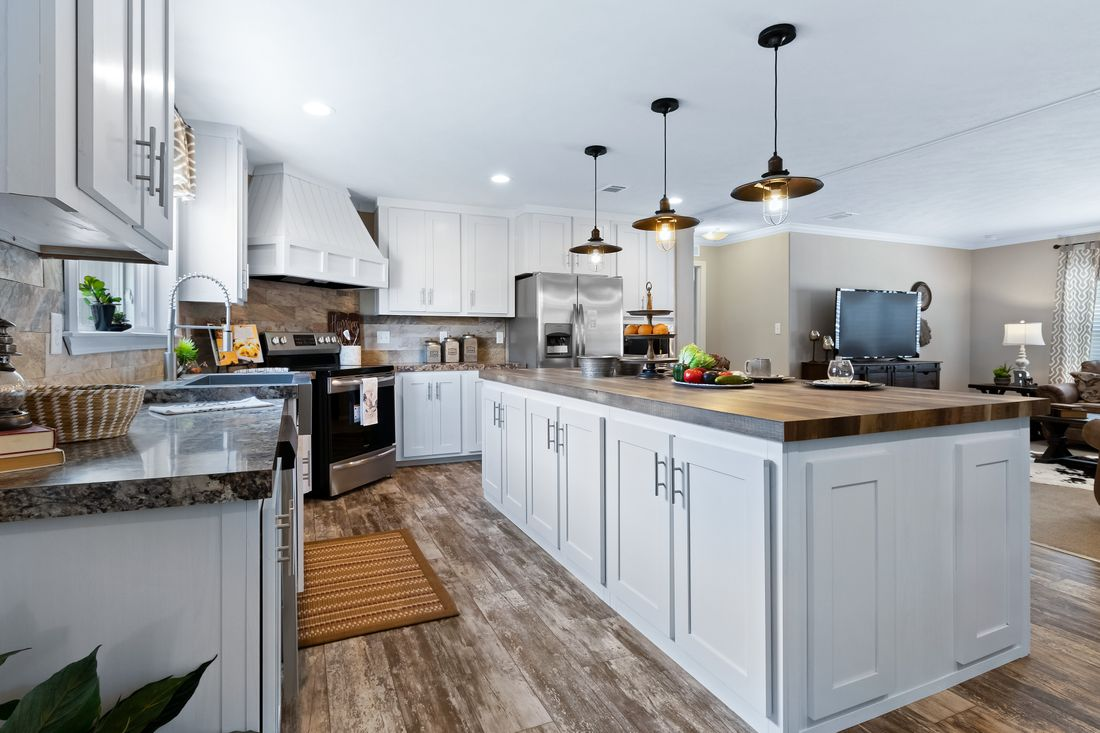 The THE DRAKE Kitchen. This Manufactured Mobile Home features 4 bedrooms and 2 baths.
