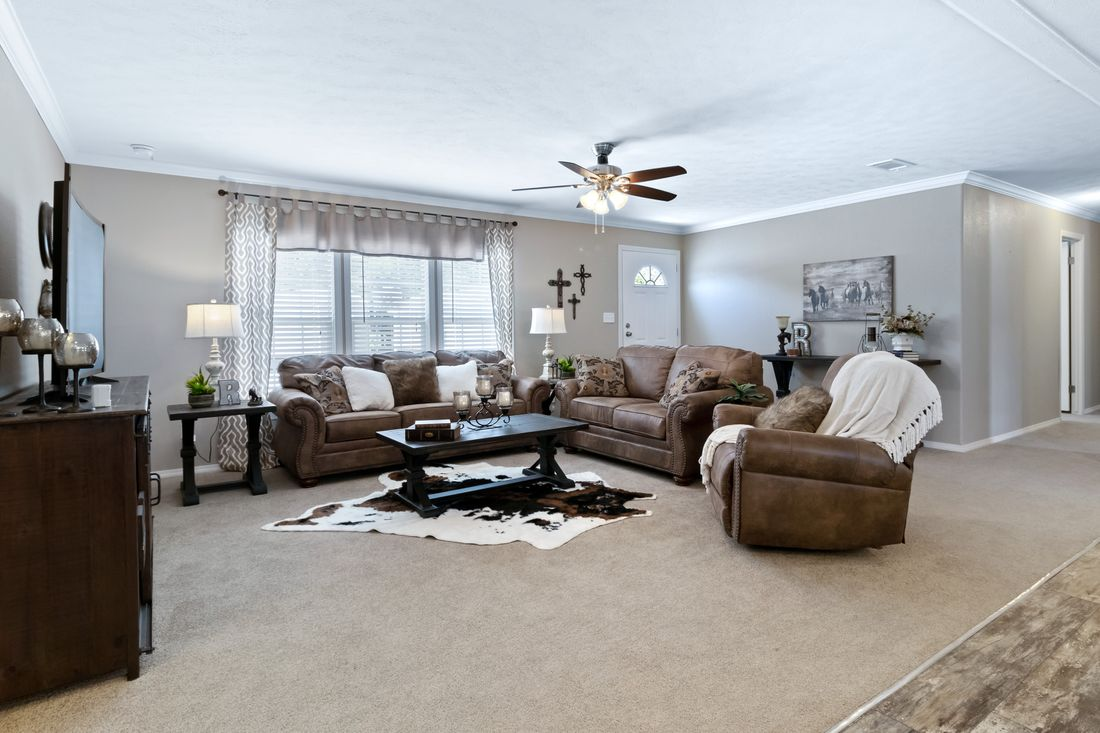 The THE DRAKE Living Room. This Manufactured Mobile Home features 4 bedrooms and 2 baths.